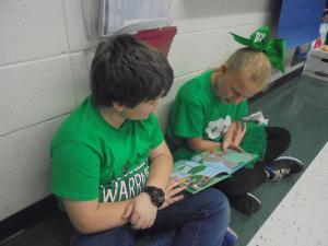 Fourth grade students reading Dr. Seuss books during Read Across America Week.
