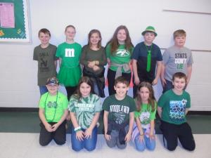Mrs. Carr's fourth grade students wore green to celebrate