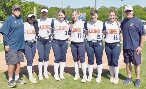 ACH Lady Lions Seniors standing together with coaches