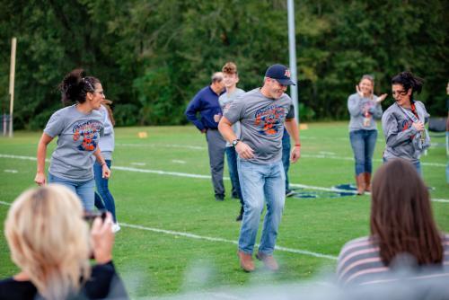 Principal Dancing on field for Homecoming