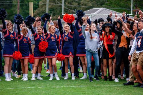 Cheer Team and students singing Alma Mater