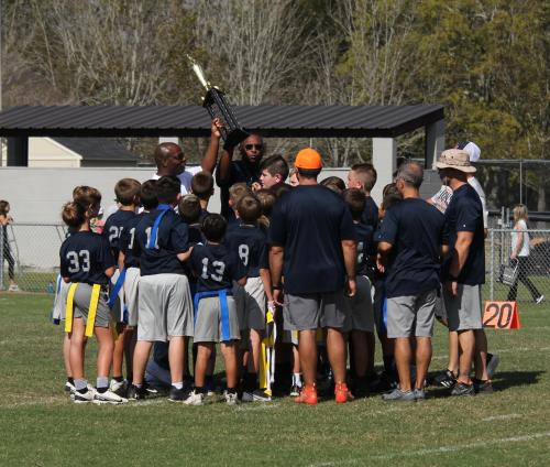 Team holding up the trophy after the game