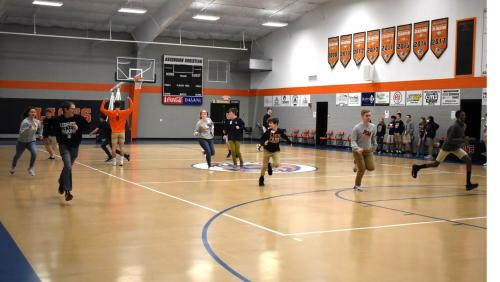 FCA Students participating in an activity in the gym