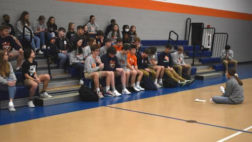 FCA Students sitting in gym praying