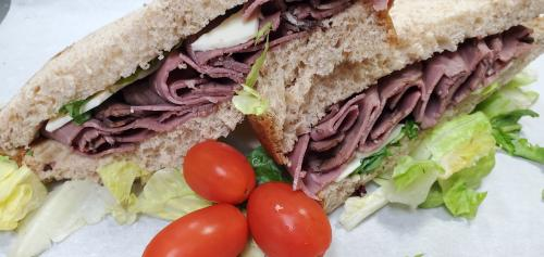 Roast Beef Po boy sandwich with cherry tomatoes and lettuce