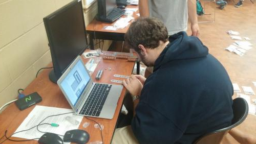 Student working on the design of a robot