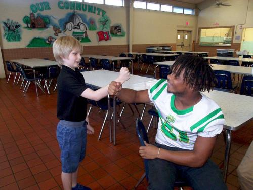 bolivar elementary student with high school student