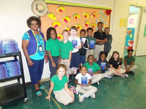 miss lawanda beasley with a group of students