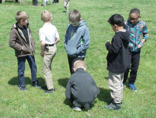 kids hunting eggs