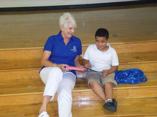 student with volunteer