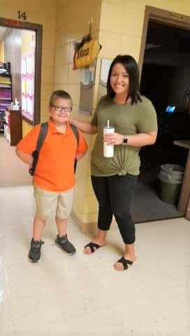 Ms. Kayla greeting her student!