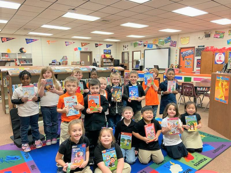 Kindergarteners with their 1st Library Book!