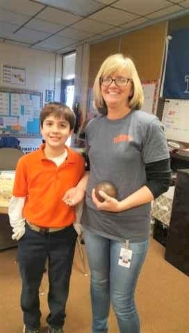 Mrs. Sharon sharing History artifacts