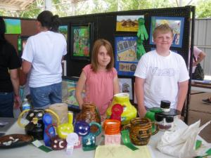 Allison and Jackson with their work at the art show.