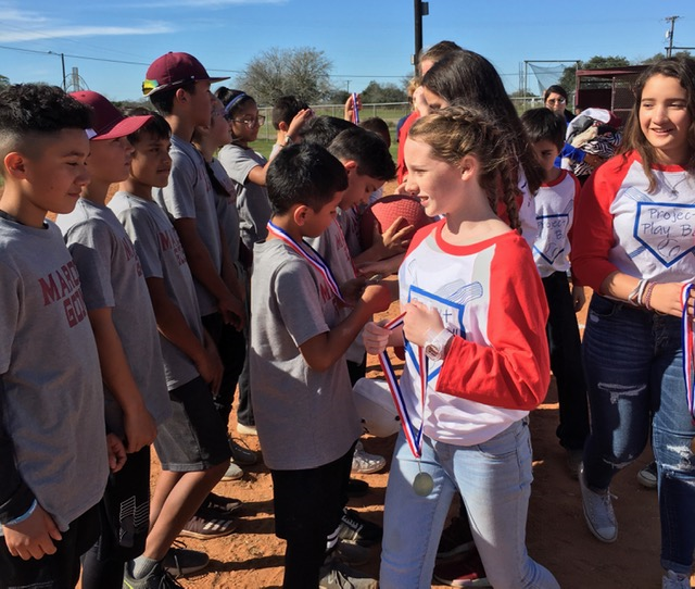 The Maroon Goons receive their first place medals from Project PlayBall! team members.