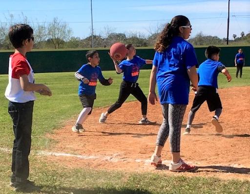 Logan Ohler covers an intense play at third base.