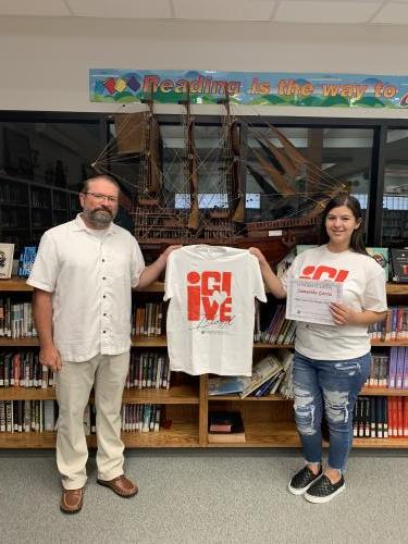 Albert Byrom, principal, and Samantha Garci T-Shirt contest winner