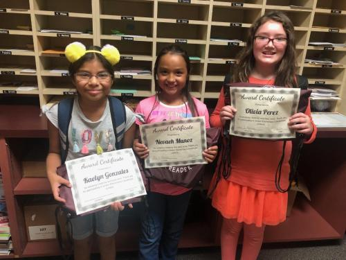 4th grade bookmark winners; 1st place Kaelyn Gonzales, 2nd Nevaeh Munoz and 3rd Olivia Perez