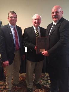 Award Winner Boyd Brown (R) Congratulated by Jay Curtis (L) Richard Strahorn (C)