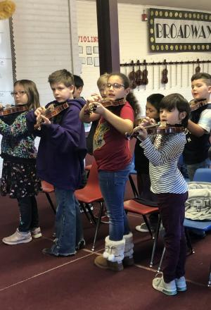 3rd Graders working on the Violins