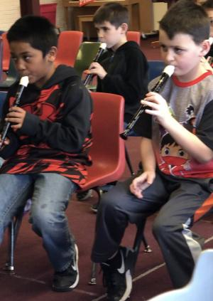 2nd graders performing on recorders