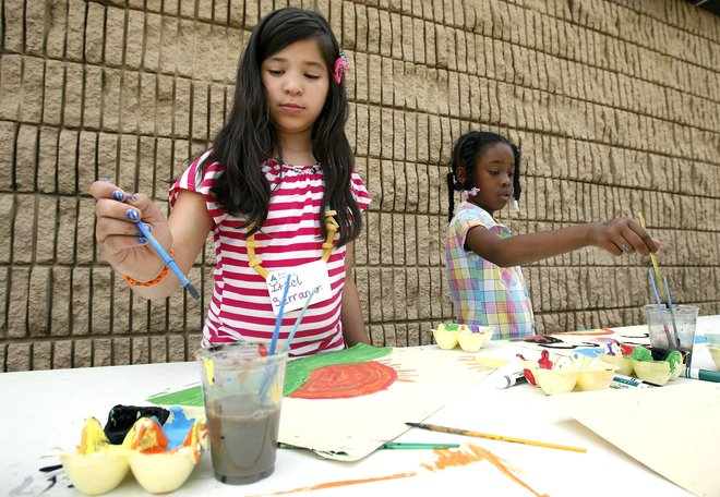 Itzel Serrano (left) and Tyawna Lark work on a painting during a summer learning camp at Roy Clark Elementary School. The Union district school will be honored Thursday in a ceremony in the nation's capital. MATT BARNARD/Tulsa World