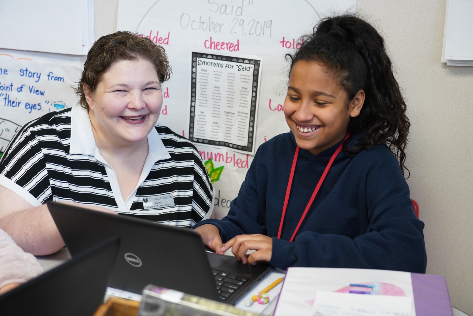 """6th Grade Center – Lynnelle Winter, Language Arts  Language Arts teacher Lynnelle Winter has been named the Union 6th Grade Teacher of the Year for 2019-2020.  Winter said she can remember going to a new school in first grade and not being able to read.  """"The teacher and principal wanted to hold me back, but my mom wouldn't let them. Instead she and I would work every evening on reading. I can still remember sitting at the table struggling to read the words,"""" Winter said. """"Once I learned how to read, it opened up a whole new world for me. I went from a struggling reader to a voracious reader in two school years.     """"Now as a sixth grade teacher, I love that I am here to help students navigate from elementary to their new stage in the journey of education-secondary. Middle school is hard for a variety of reasons. Students all need to feel loved and supported. This is why I teach this age group.  Adolescence is a hard time period, I know many of us would not want to relive those years. But, maybe, my sixth grade Cornell Students can have a positive first experience with their secondary education. I want their years 'in the middle' to be ones filled with positivity, acceptance, and love."""" Winter said her favorite subject to teach is writing.   """"I write alongside my students, so the mini-lessons I am asking them to complete I have also completed the activity or lesson,"""" she said.  """"I discuss my struggles as a writer also. It helps them realize teachers are human also and we might have areas we struggle in too.   Teaching sixth graders how to appropriately use their voice is empowering.  When they realize their words have the power to  change procedures, someone's thinking,  or mind.  It's one of the greatest roles of my job...to observe students taking risks with their thoughts or writing or voice.  And then to see the impact in students of their self- realization is so very important.  It's such an honor to witness it.""""    Winter started teaching in August 2013.  """"(Th"""