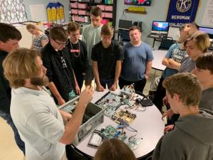 Eli teaching Mrs. Ply's Class how to dissect computers