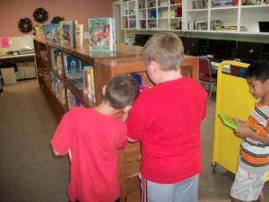 First graders looking for books to read.