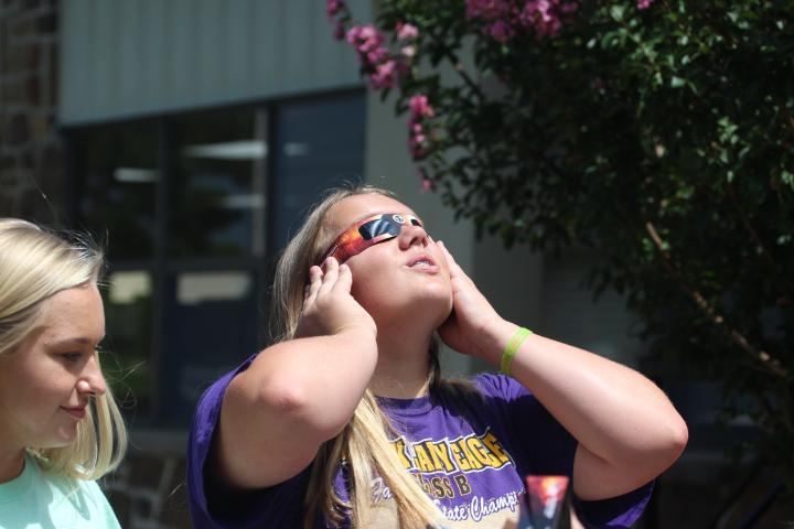High school science students check out the eclipse.