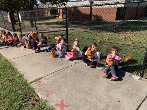 Decorating our pumpkins.