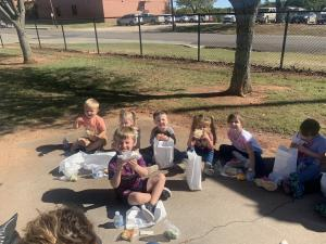 Picnic lunch around the flag pole.