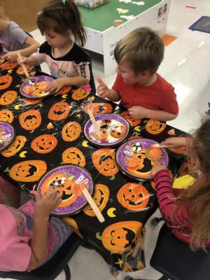 Creating our cookie masterpieces.