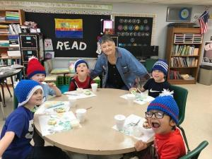 Mrs. Mary and the first grade boys wearing their hats she made