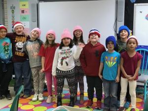 Second grade class wearing the hats Mrs. Mary made