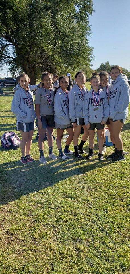 Junior high girls getting ready to run