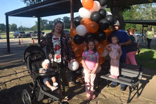 Family with balloons