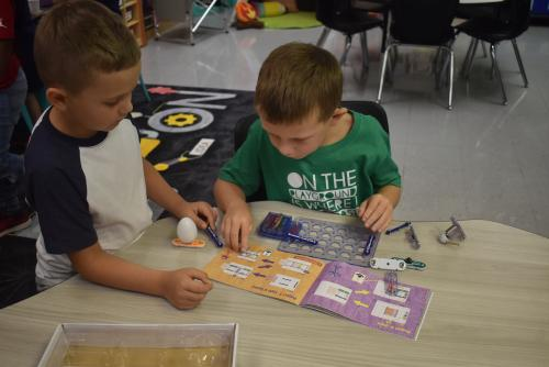 Student building circuits