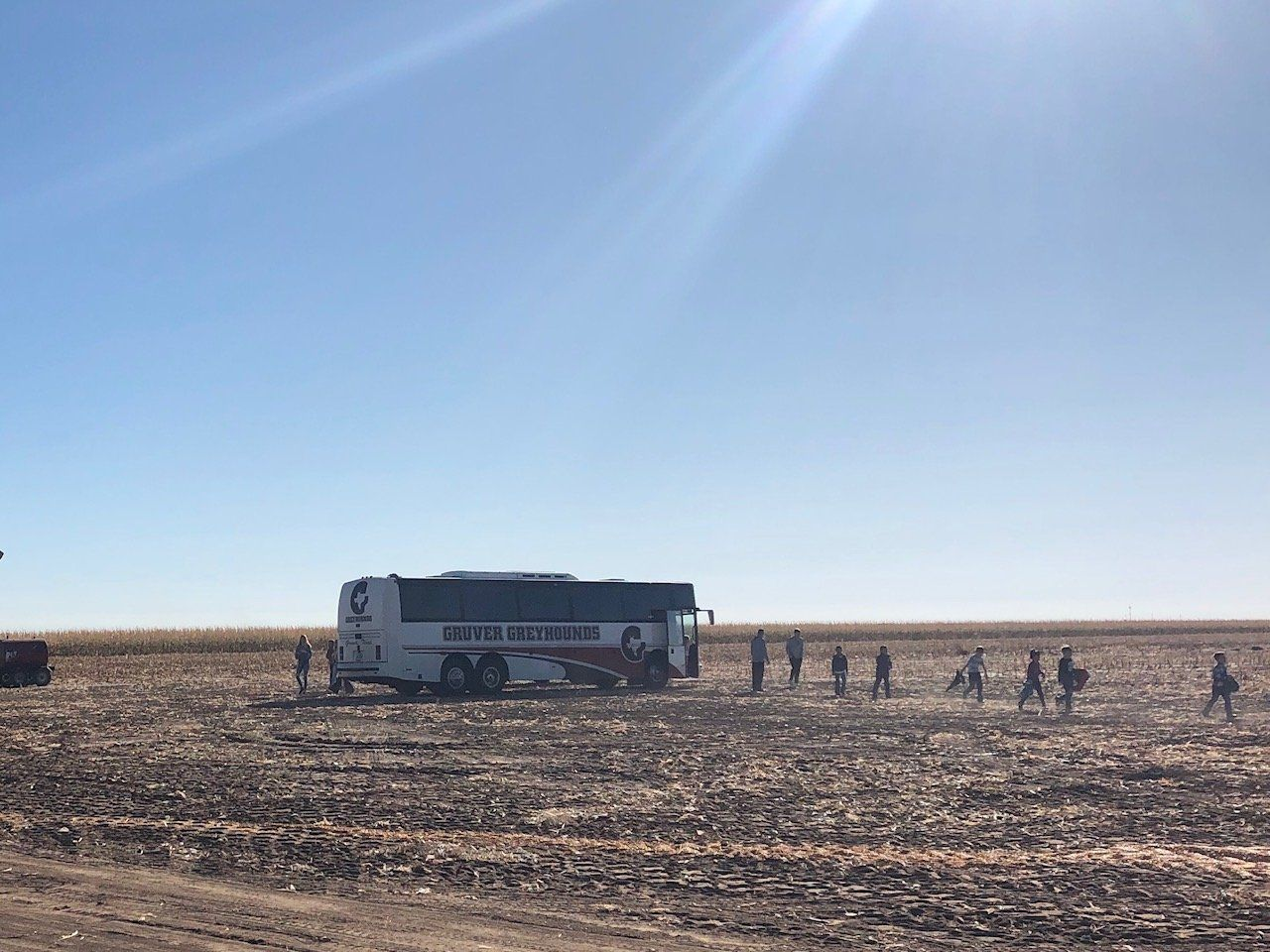 Students visit farm site during harvest.
