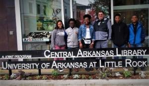 Zakya Hill, Devon Conway, N'Kyia Randall, Mr Plant, Montrey Guidrey & Jonovan Gamble researching student-centered project for Black History Month