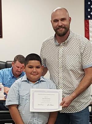 Board Member Patrick Debusk presented Luis Rendon with Certificate of Appreciation During September Board Meeting