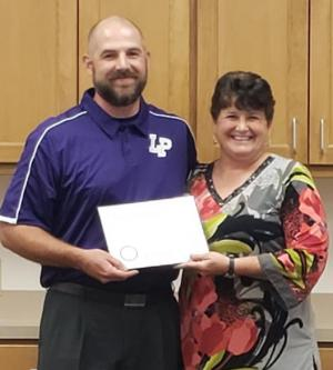 Secondary Principal Mrs. Crystal Woodard presented Mr. Jammie Maze with an Outstanding Educator Achievement Certificate for Grade 8 Social Studies 2019 and Science Distinction Award 2019 EOC