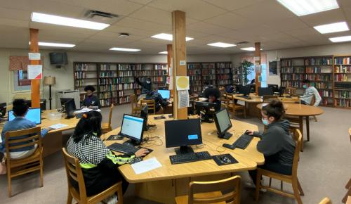 Students working on library computers