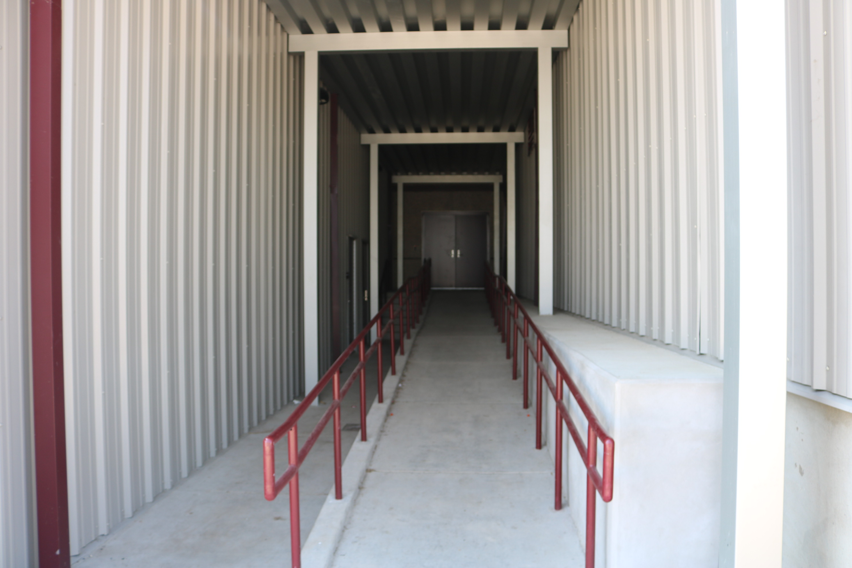 Covered walkway to Greenhouse and Ag Mechanics