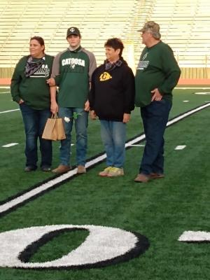 Charlie Potter with mom and Grandparents on Senior night