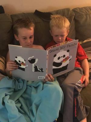 Jaxon and Mattox reading together.