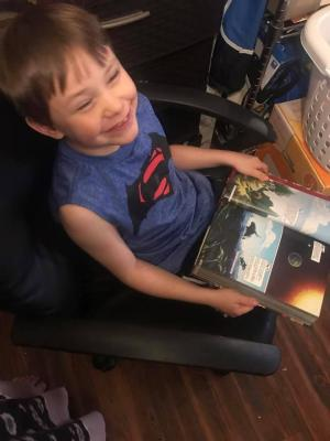 Cayden enjoys a good book.