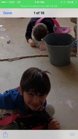 Cayden and Christian get creative with sidewalk chalk.