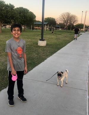 Elijah Perez enjoying a walk with his dog.