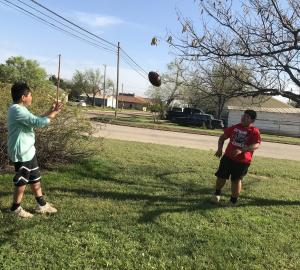 Jacob Rodriguez tossing the football with a friend.